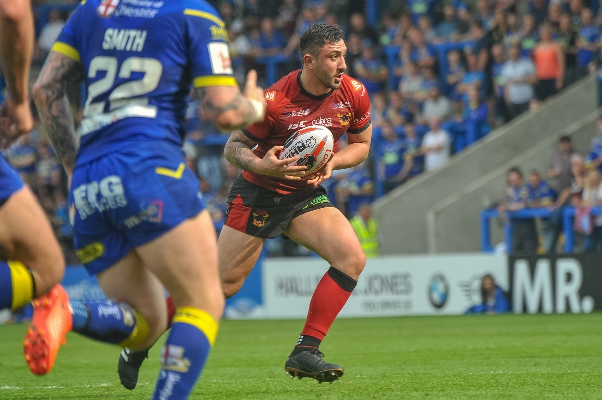 ON THE ATTACK: Elliot Minchella looks for an opening in the Warrington defence. Pic: Tom Pearson