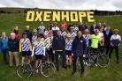 Tour De Yorkshire preparations head to Oxenhope and a set of giant letters on the hilside with Sir Gary Verity Christian Prudhomme joined by local cycling clubs..