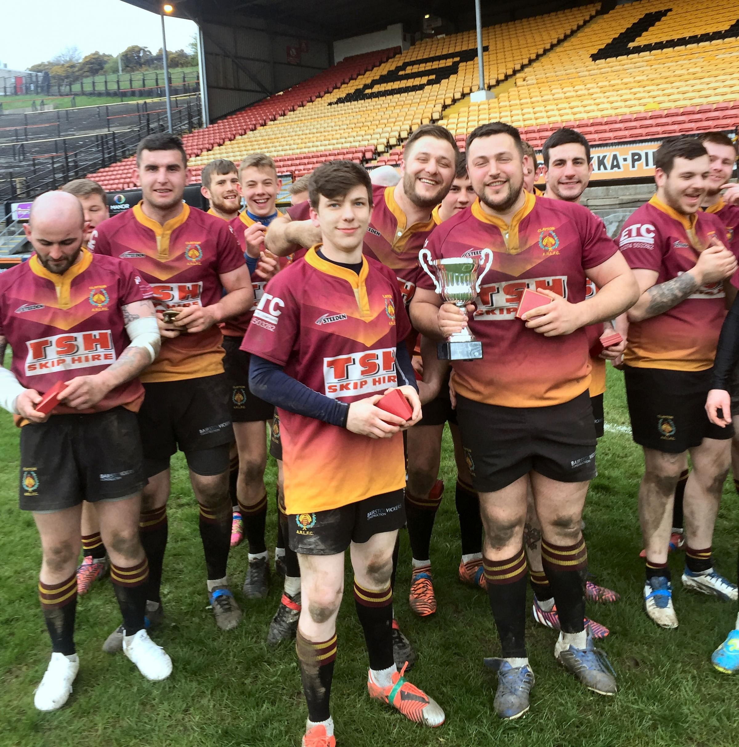Clayton celebrate their the Hudson Foster Supplementary Bradford Cup final victory
