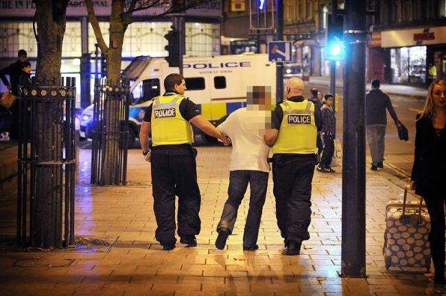Police pursue and arrrest a drunk on a Friday night in Bradford City centre.
