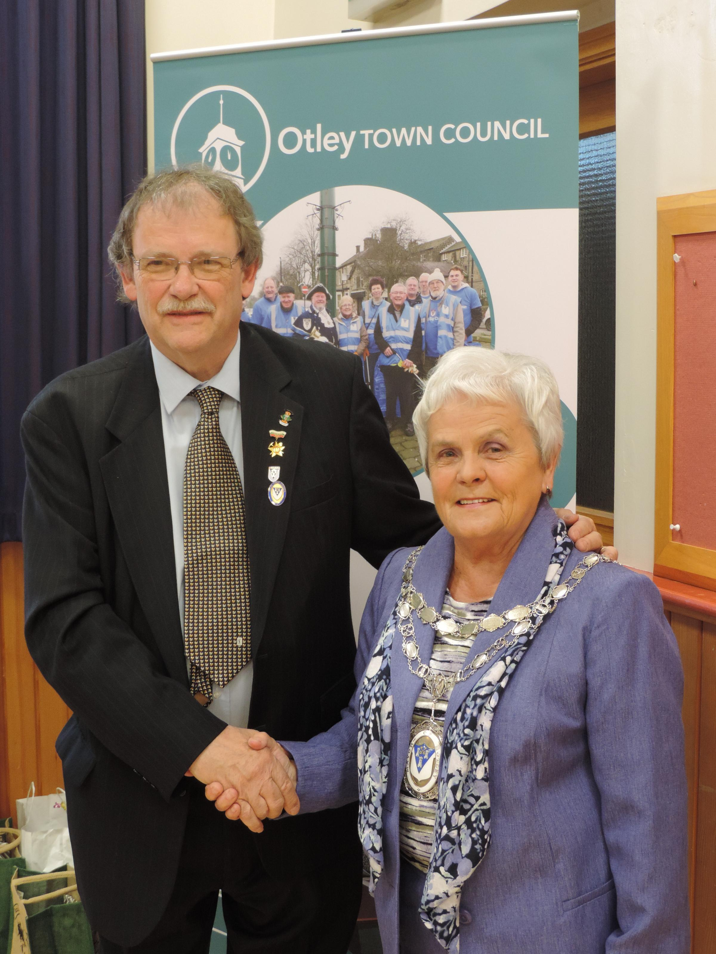 Handover - new Otley Town Mayor Councillor Mary Vickers accepting the chains of office from retiring mayor Councillor Nigel Francis