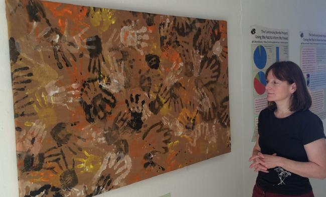 Dr Karina Croucher with the image created by some of the people who participated in the scheme