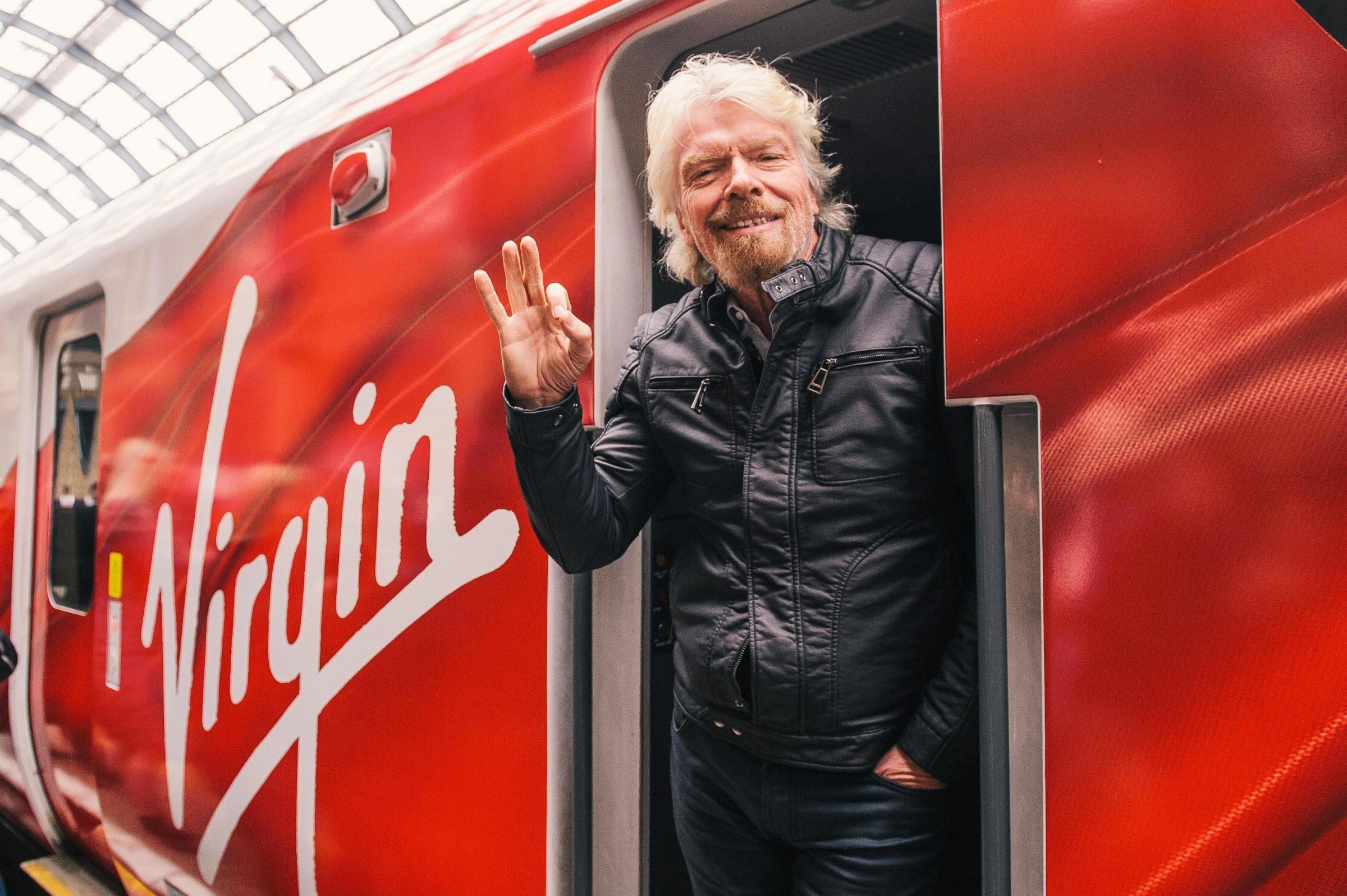 Undated handout file photo issued by Virgin Trains of Sir Richard Branson unveiling the Virgin Azuma, the first of their new fleet which will cut journey times on the East Coast Main Line by up to 22 minutes, at King's Cross station in London. Rail se