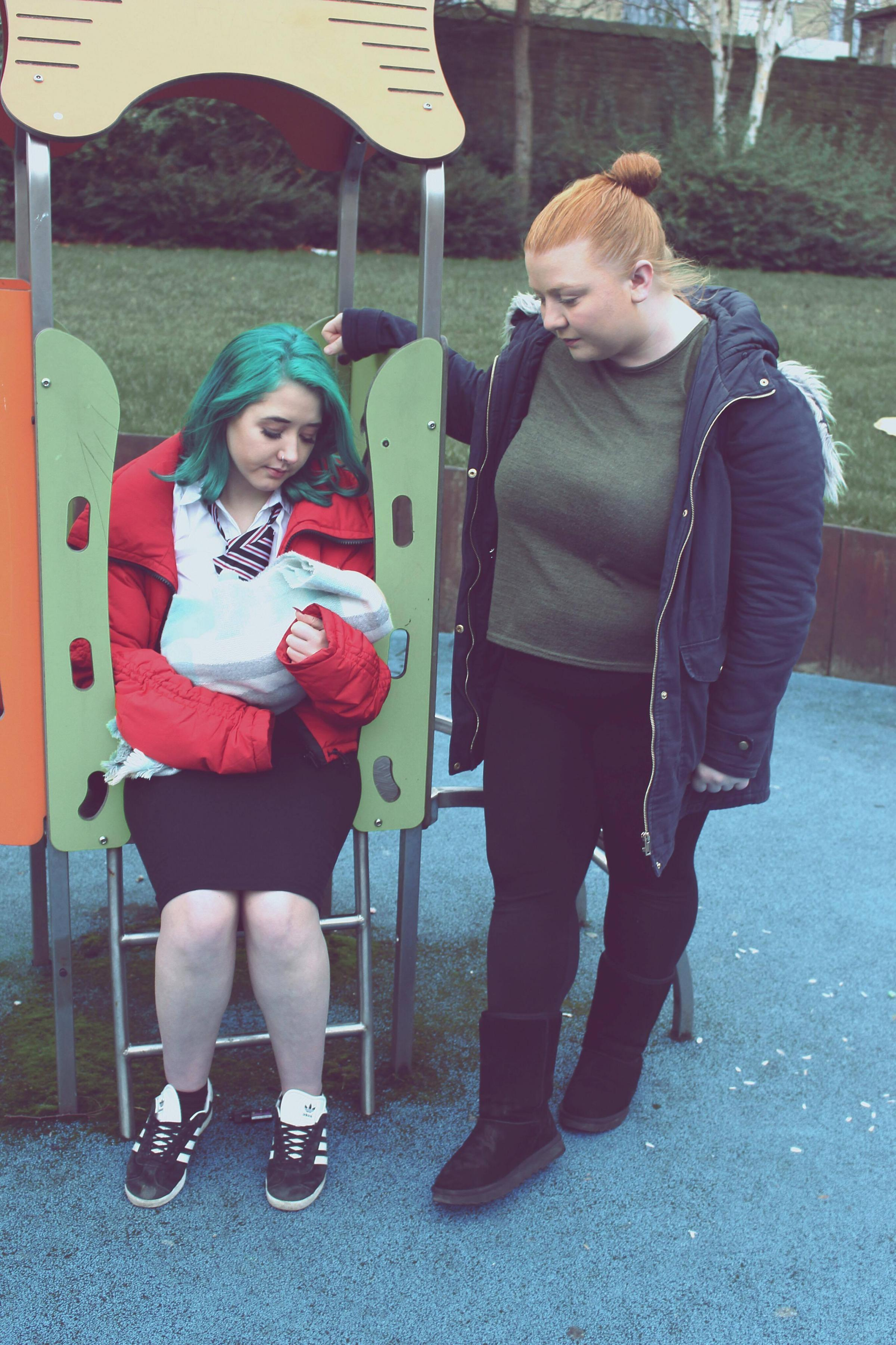 Leah Hand as Brenda and Katie Mahon as Amy in the play 'Brenda's Got a Baby' by Bloomin' Buds Theatre Company