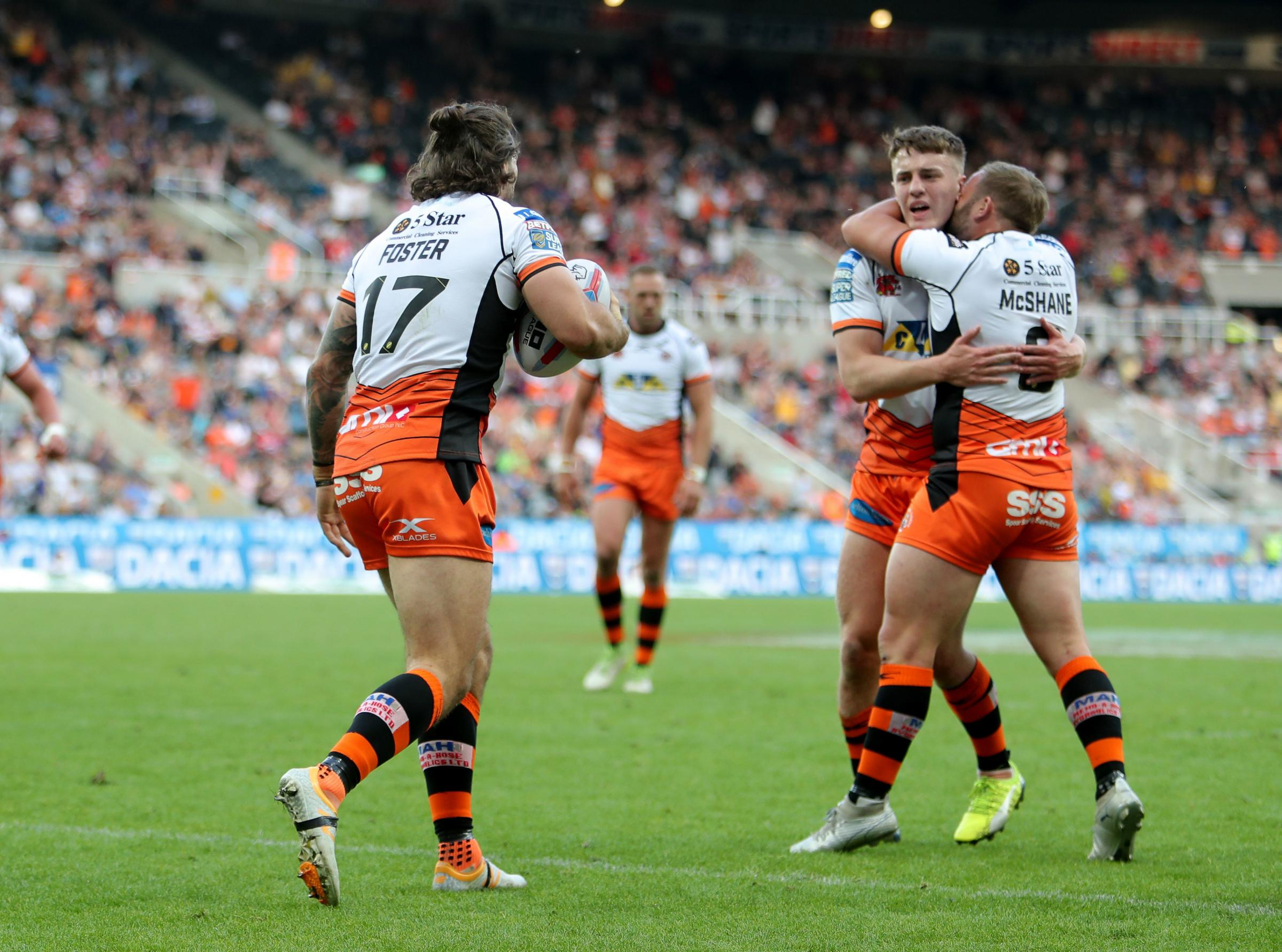 Castleford Tigers' Alex Foster celebrates with Jake Trumeman and Paul Mcshane during the Betfred Super League, Magic Weekend match at St James' Park, Newcastle. PRESS ASSOCIATION Photo. Picture date: Saturday May 19, 2018. See PA story RUGBYL Cast
