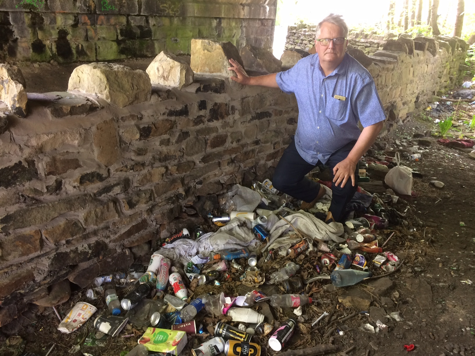 Cllr Peter Madeley and rubbish under the Keighley Road railway bridge