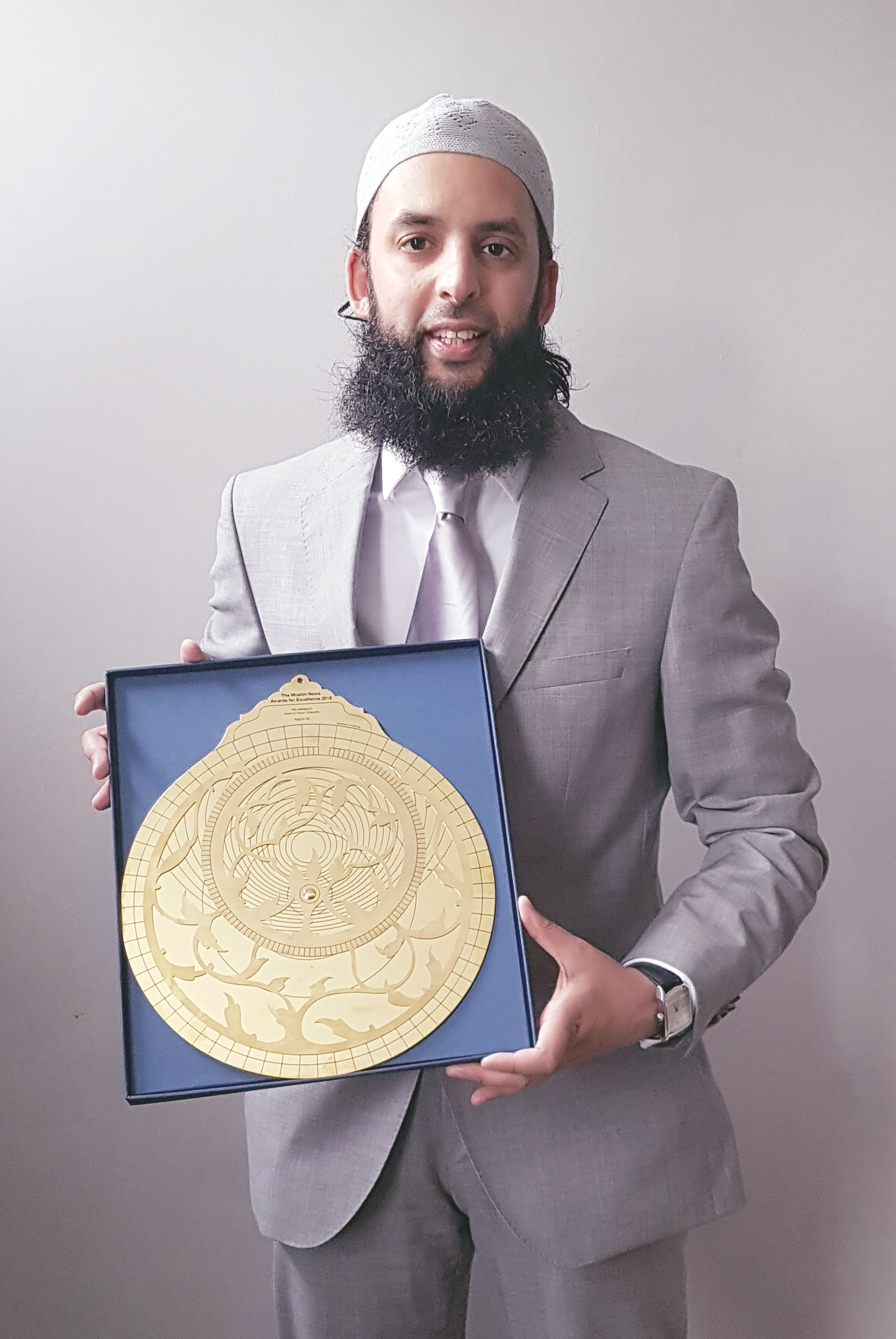 AWARD: Manningham's Nazim Ali with his prize for  good citizenship from this year's Muslim News Awards