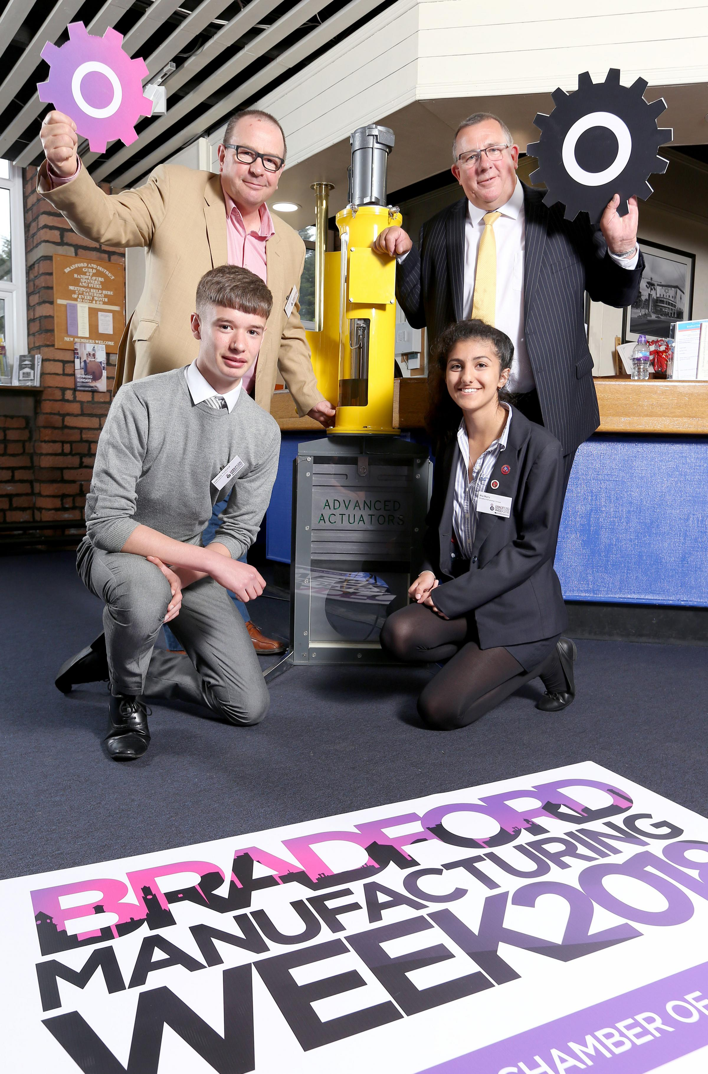 Chris Woodhead of Advanced Actuators and Nick Garthwaite of Christeyns with students Gabrielle Tankard and Nia Naru