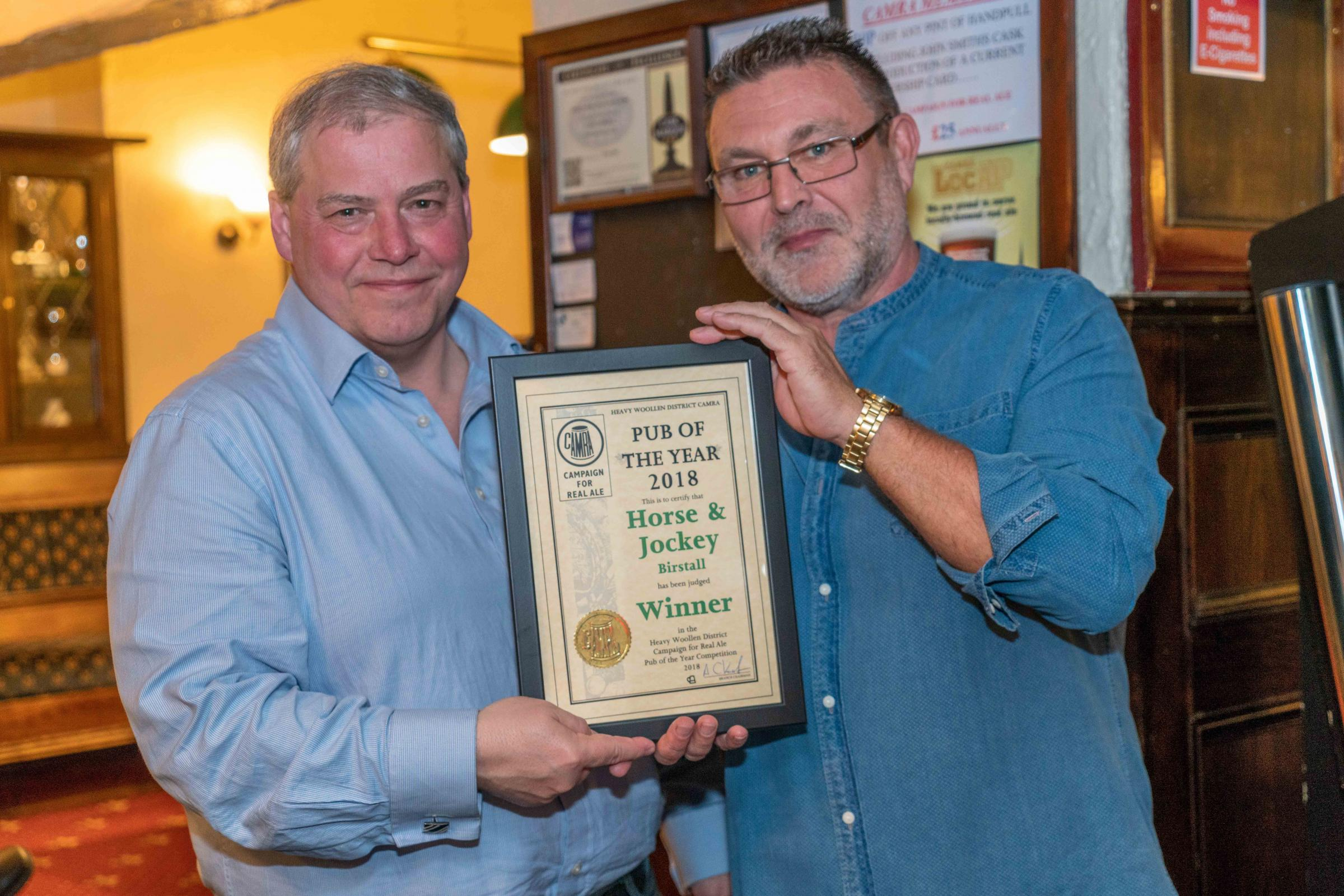 Chairman of the Heavy Woollen CAMRA branch Andy Kassube with Tony Anderson who runs the Horse and Jockey, which has picked up the Pub of the Year award