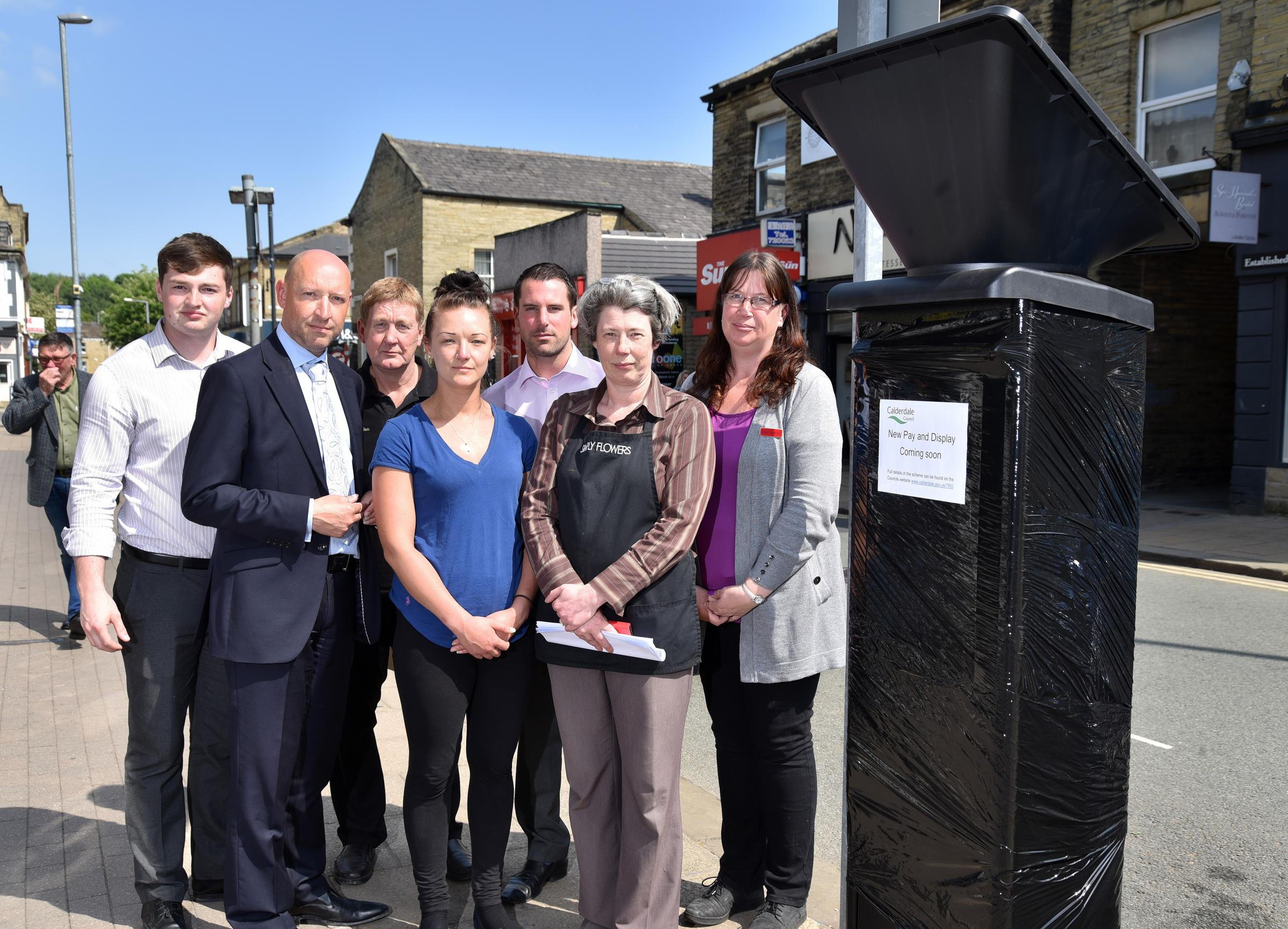 METERS: Cllr Scott Benton and traders in Brighouse are concerned about the introduction of parking charges