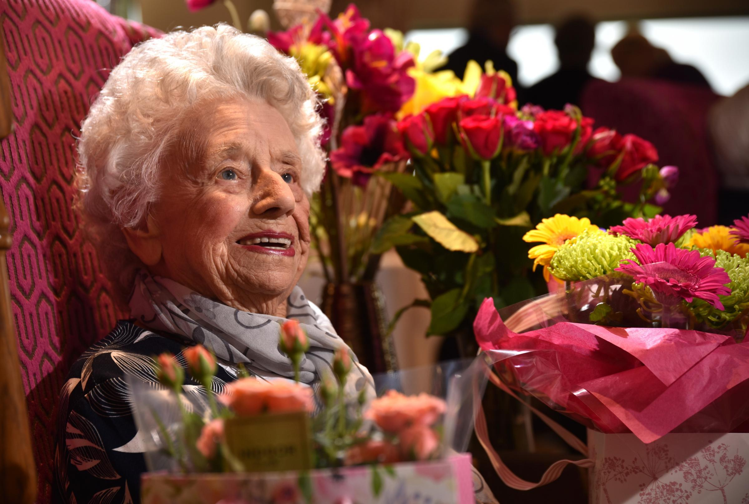 CELEBRATIONS: Marjorie Smith is thrilled with her flowers as she celebrates her 100th birthday