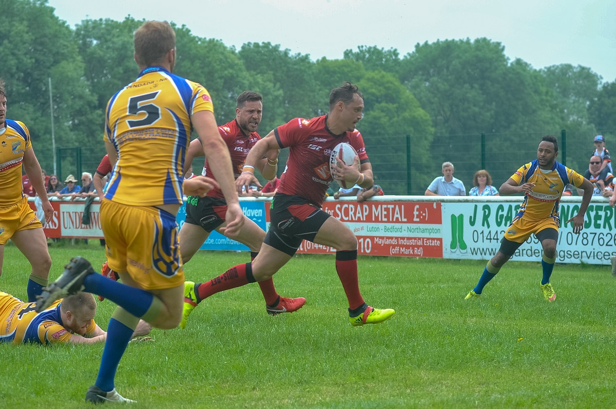 Dane Chisholm runs through to score the Bulls' opening try. Pic: Tom Pearson