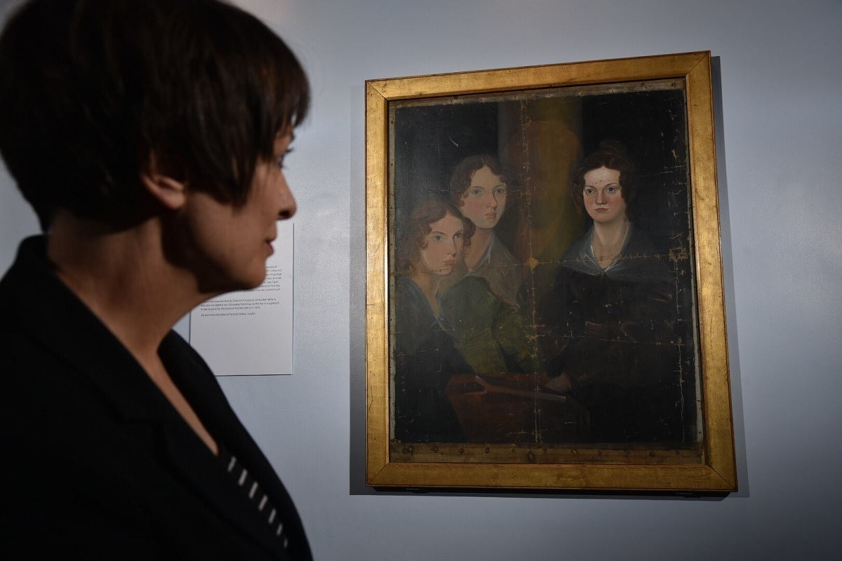 Ann Dinsdale, Principal Curator, with the painting of the Bronte Sisters, which has returned to the Bronte Parsonage