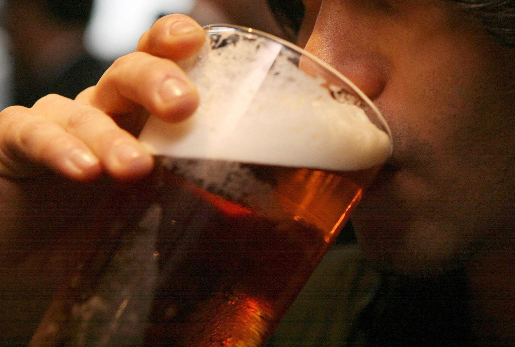A man drinking a pint of beer. Picture: Johnny Green/PA Wire