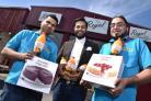 Waqar Younis (centre) from Regal Foods with Ahmad Akram, left,  and Abdul Satar who organise the cake sales