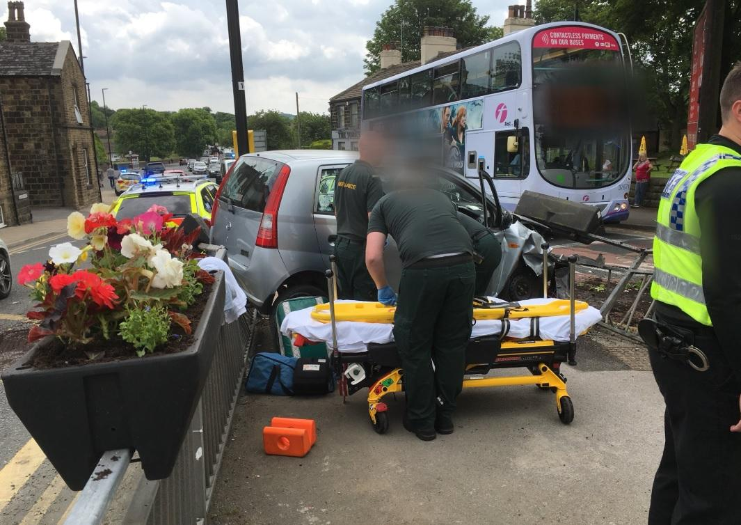 woman suffers only minor injuries after crashing into railings near