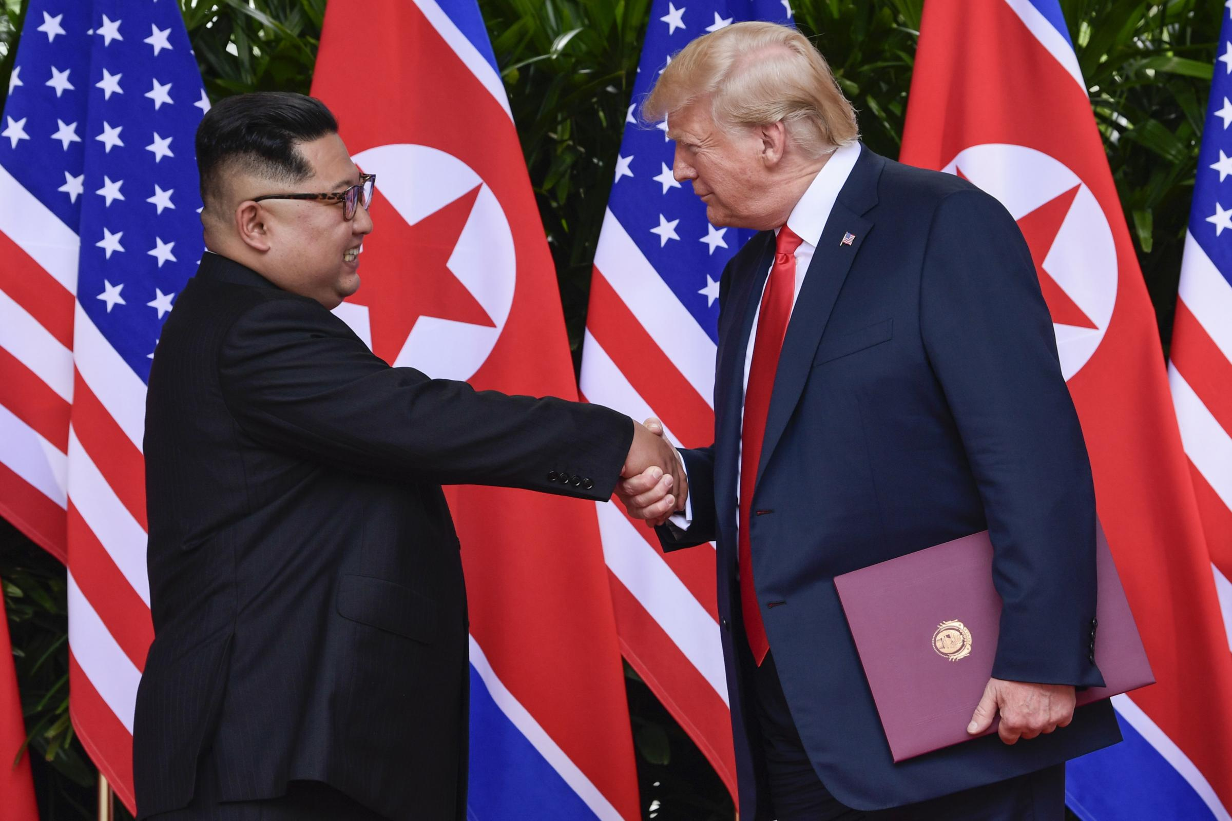 North Korea leader Kim Jong Un and U.S. President Donald Trump shake hands at the conclusion of their meetings at the Capella resort on Sentosa Island Tuesday, June 12, 2018 in Singapore. (AP Photo/Susan Walsh, Pool)