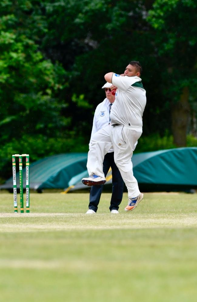 Crossflatts' Wasim Hussain starred in Craven's narrow win over Show, taking 4-38 in his eight overs Picture: Andy Garbutt