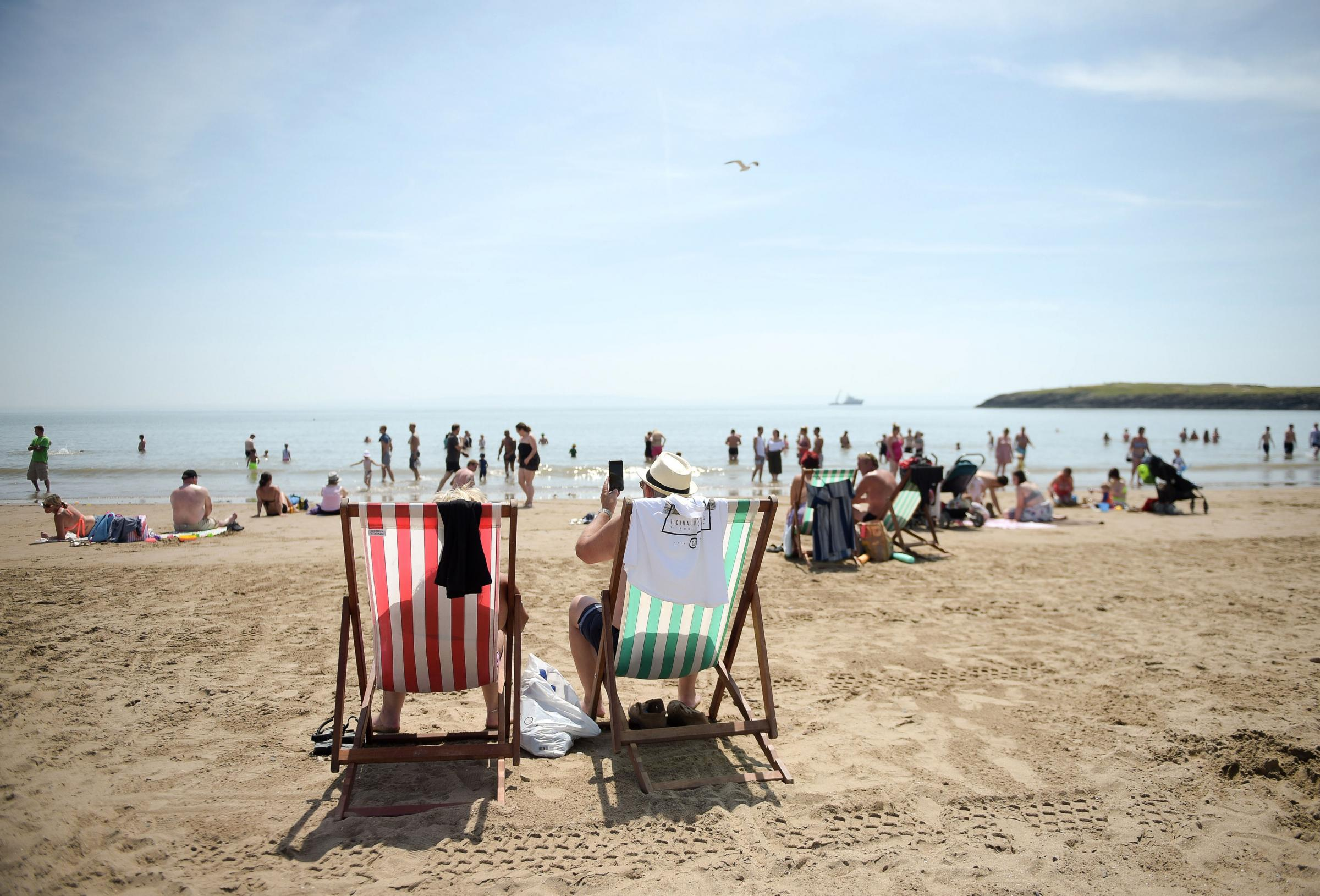TAKE CARE: Hats on and suncream applied in the sunshine Photo: Ben Birchall/PA Wire