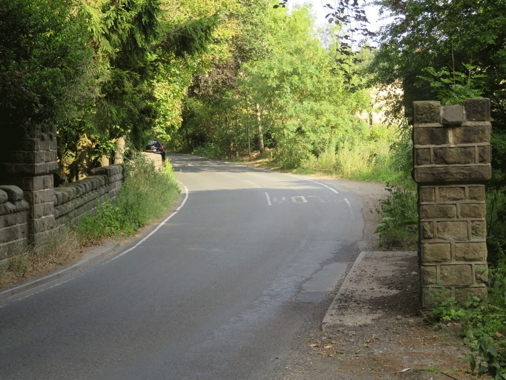 The photograph shows the road bridge over Coldstone Beck looking towards Burley Woodhead, with the proposed site of the footpath on the right