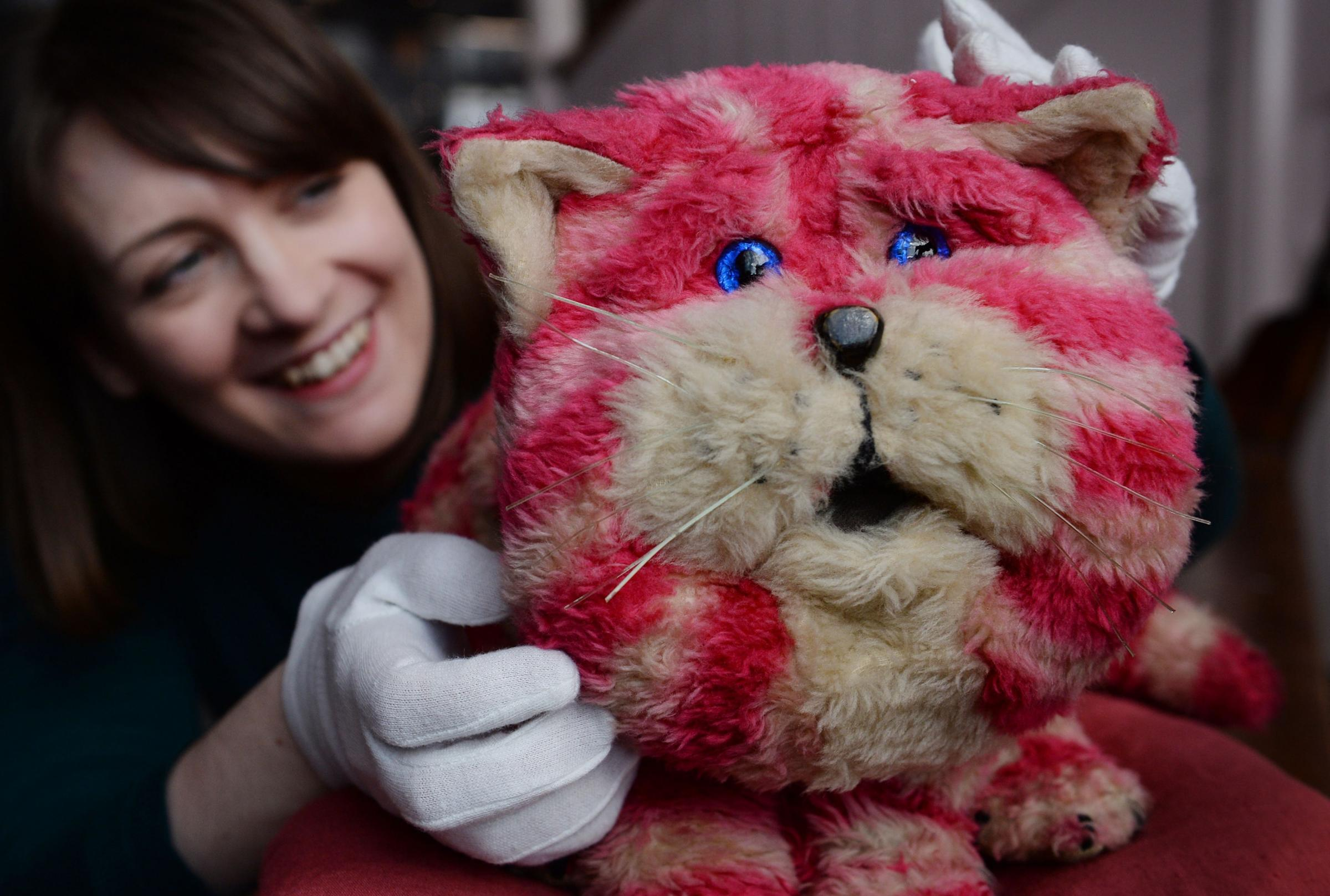 Alice Sage, Curator at the V&A Museum of Childhood in east London with Bagpuss, the puppet used in the 1970s children's TV show. Photo: Stefan Rousseau/PA Wire