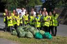 The group from Beckfoot Oakbank, with their supporters, and the bags they filled with rubbish during the clean up