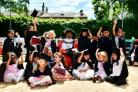 PROUD: Mini graduates throw their caps in the air at Russell Street Day Nursery, Little Horton