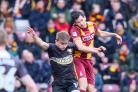 George Miller, left, in action against City's Ryan McGowan last season. Pic: Thomas Gadd