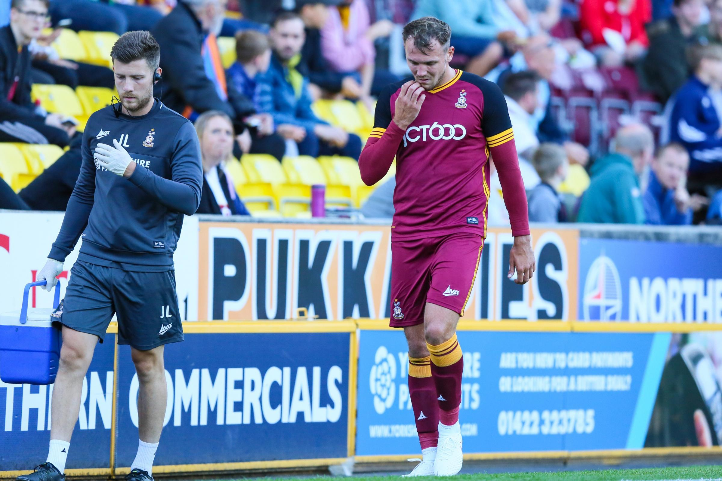 Bantams v Sheffield United: Charlie Wyke hobbles off with a suspected recurrence of his knee injury after just eight minutes  Pictures: Tom Gadd
