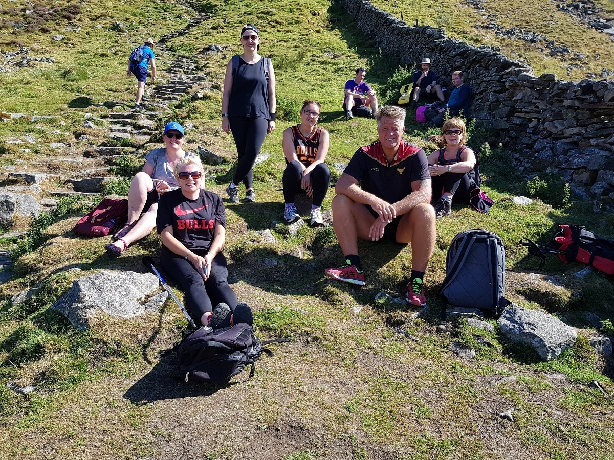 TAKE A BREAK: Head of Youth John Bastian has a breather at the foot of Ingleborough with his fellow BullBuilder walkers