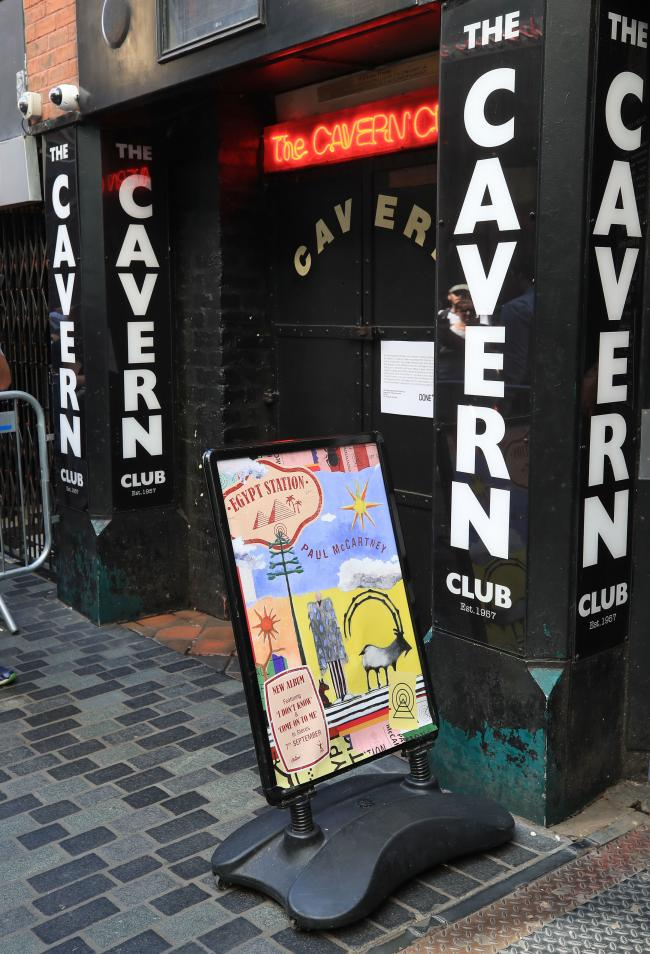 A sign board outside the Cavern Club in Liverpool before an exclusive Sir Paul McCartney gig. PRESS ASSOCIATION Photo. Picture date: Thursday July 26, 2018. The Beatle will take to the stage in the famous venue on Mathew Street, Liverpool, for an exclusiv