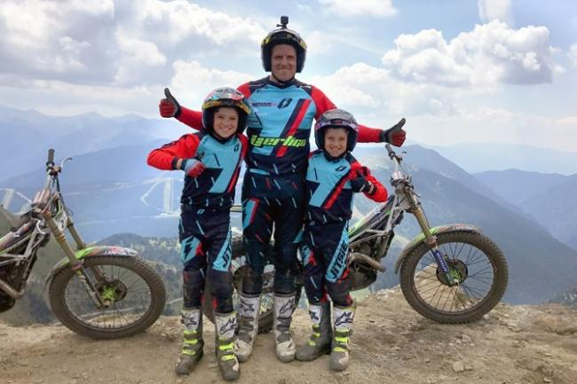 Dougie Lampkin, with his sons Alfie and Fraiser, after his victory in the mountains of Andorra