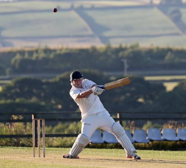 Jordan Powell slashes into the offside on his way to a 14-ball 50 for Denholme against Crossflatts