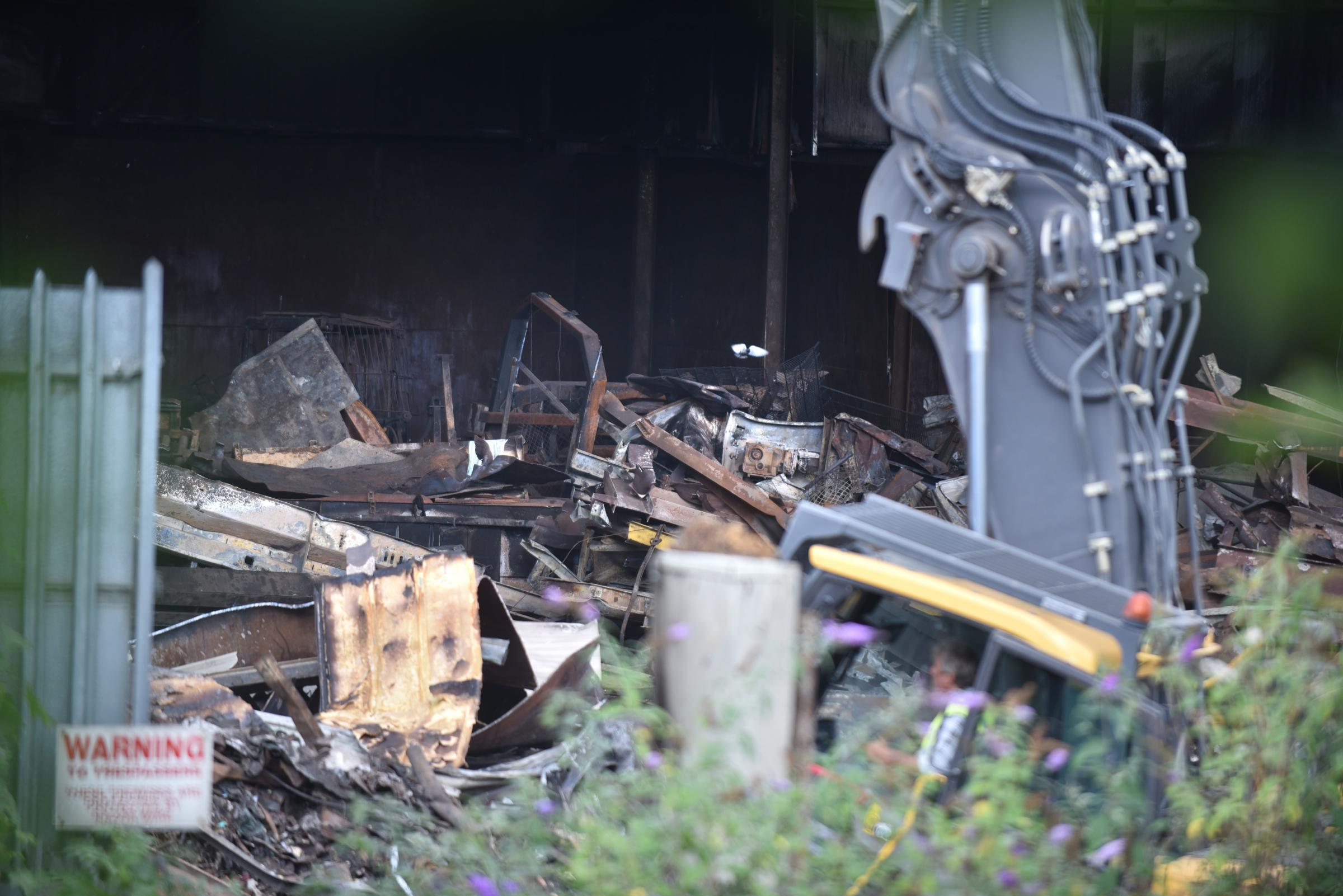 KNOCKED DOWN: Work continues to demolish fire-wrecked structures at AWM in Frizinghall