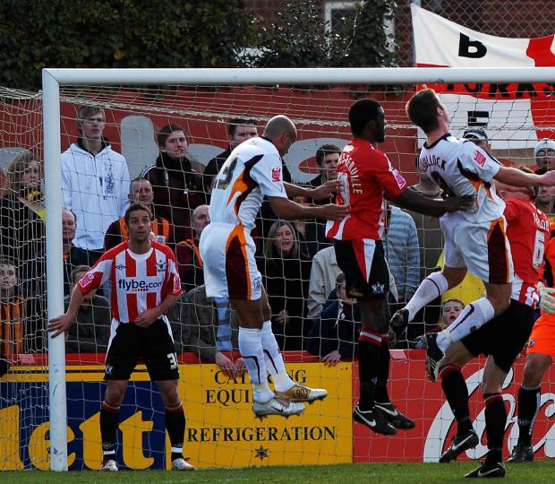 Bradford Telegraph and Argus: Lee Bullock is unable to keep his header down as City threaten an equaliser from a corner
