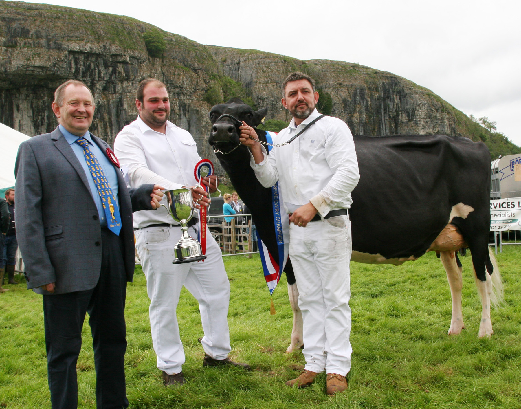 Michael and William Oldfield of Gisburn showed the Supreme Dairy Champion at Kilnsey Show. From left are judge Robert Butterfield, Bentham, William Oldfield and Isaac Lancaster. Picture by Moule Media
