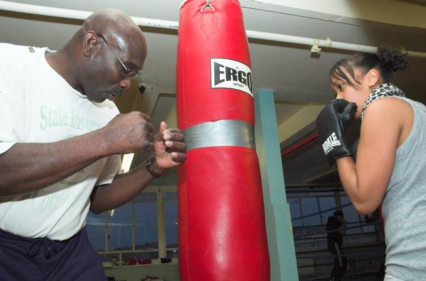 Former amateur boxer Byron Francis with one of the youngsters at Huggy's Gym