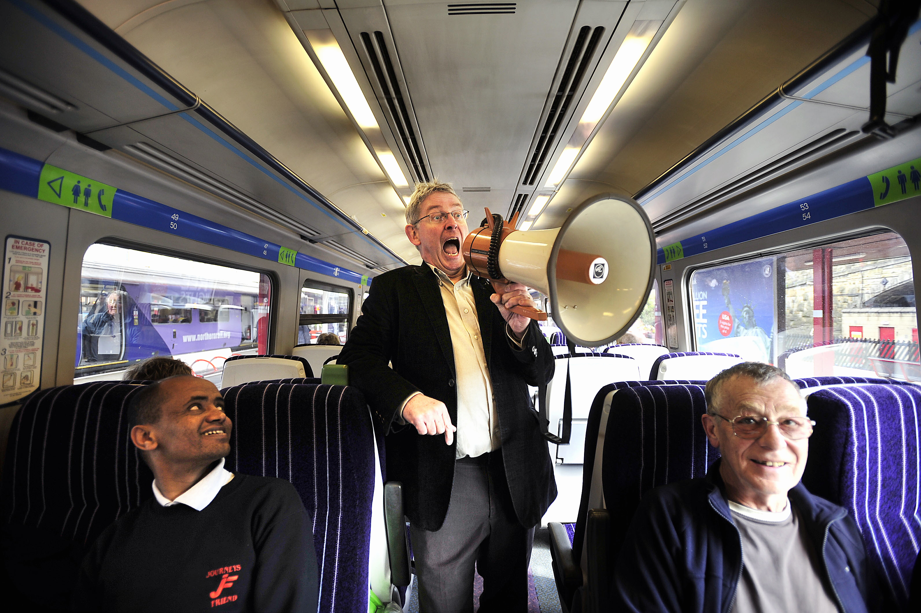 Voice of the rails Phil Sayer gets ready to surprise passengers at Bradford Interchange. Picture by Andy Garbutt
