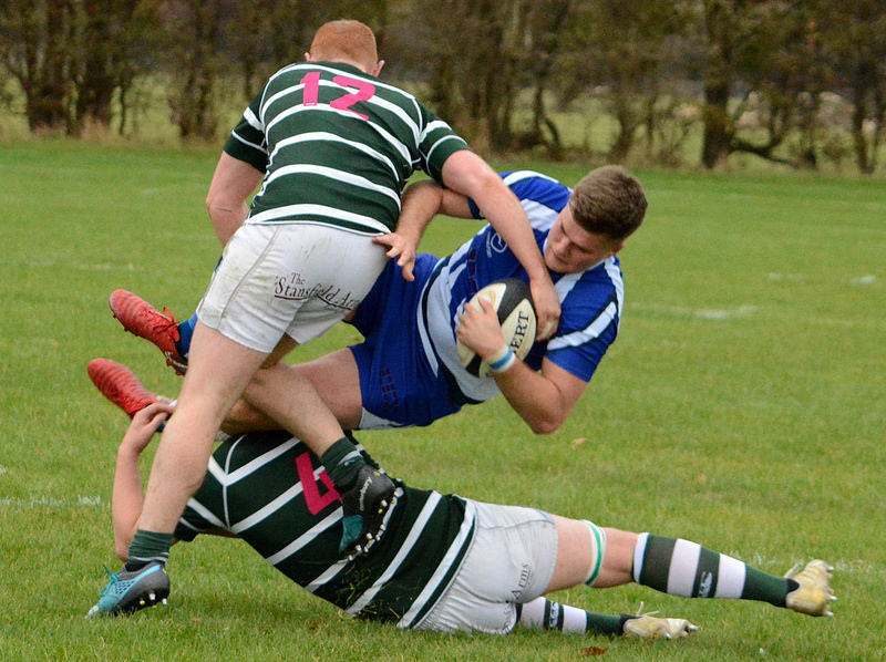 Oliver Eaves is tackled by the Grovian defence  Picture: Roy Appleyard