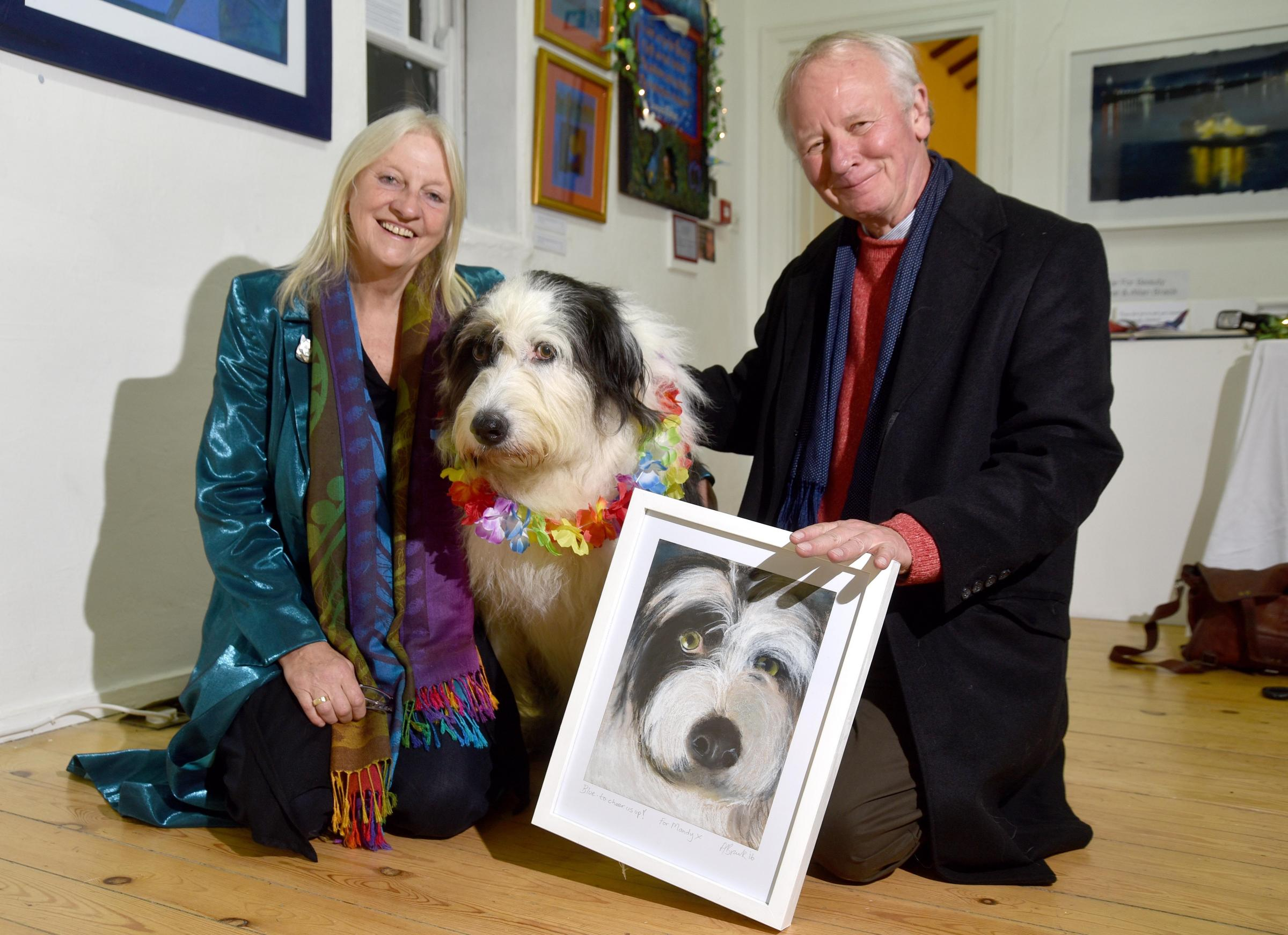 Mandy Farrar and Allan Brack with a painting of Blue the dog