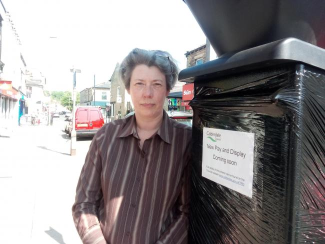 Lesley Adams of Brighouse BID pictured when charging machines for on-street parking were introduced in Brighouse in late spring