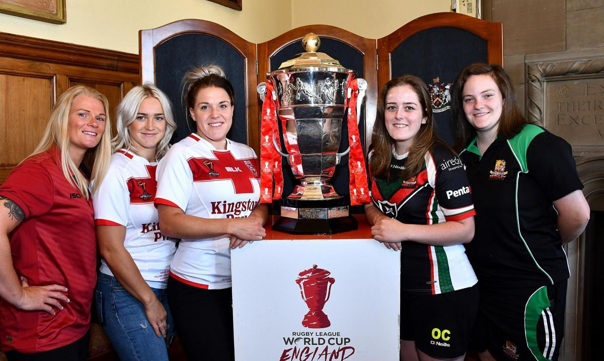 Bradford Bulls and Keighley Cougars Women's team players are pictured with the World Cup when it was on show in Bradford City Hall last August - both clubs are part of Bradford Council's bid to stage women's World Cup matches in 2021