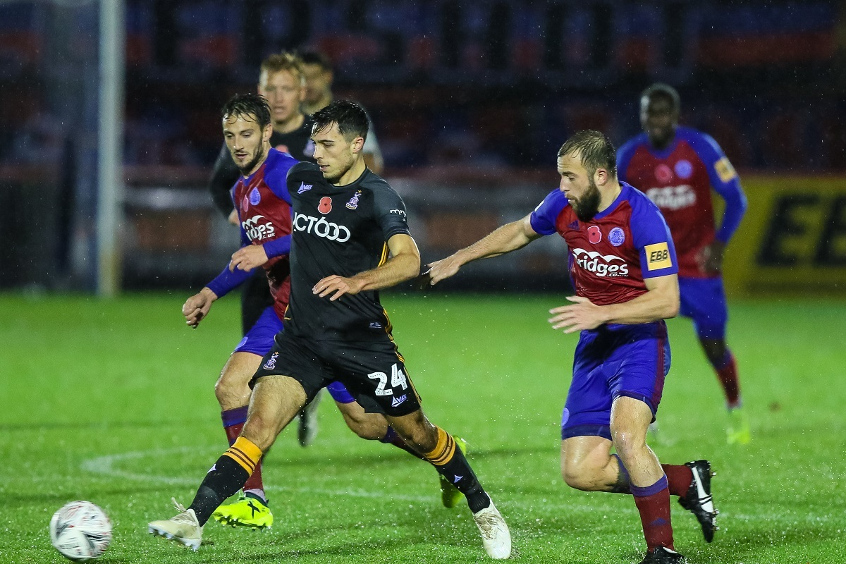 Danny Devine gets stuck in during his City comeback at Aldershot. Pic: Thomas Gadd
