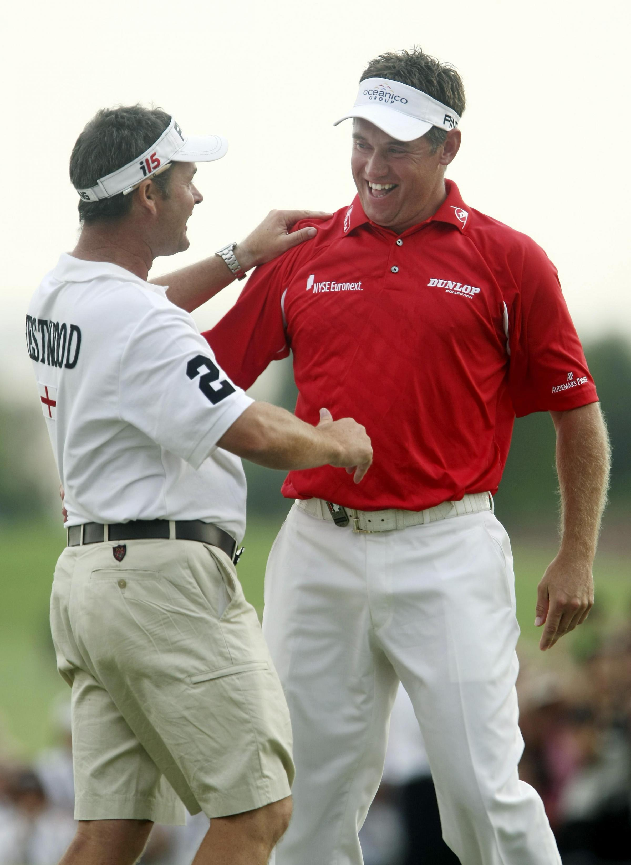 FLASHBACK: Bingley St Ives caddy Billy Foster celebrates with Lee Westwood, right, during the Englishman's Race to Dubai success in 2009. The pair have ended their ten-year partnership