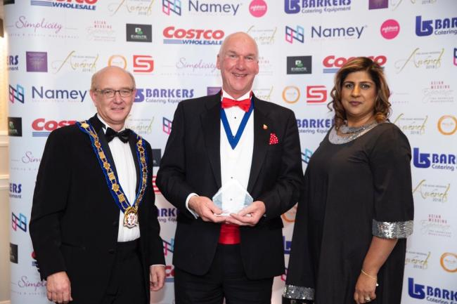 George Pye, of Burley-in-Wharfedale, is pictured centre receiving his award at the Asian Wedding Awards held in Manchester