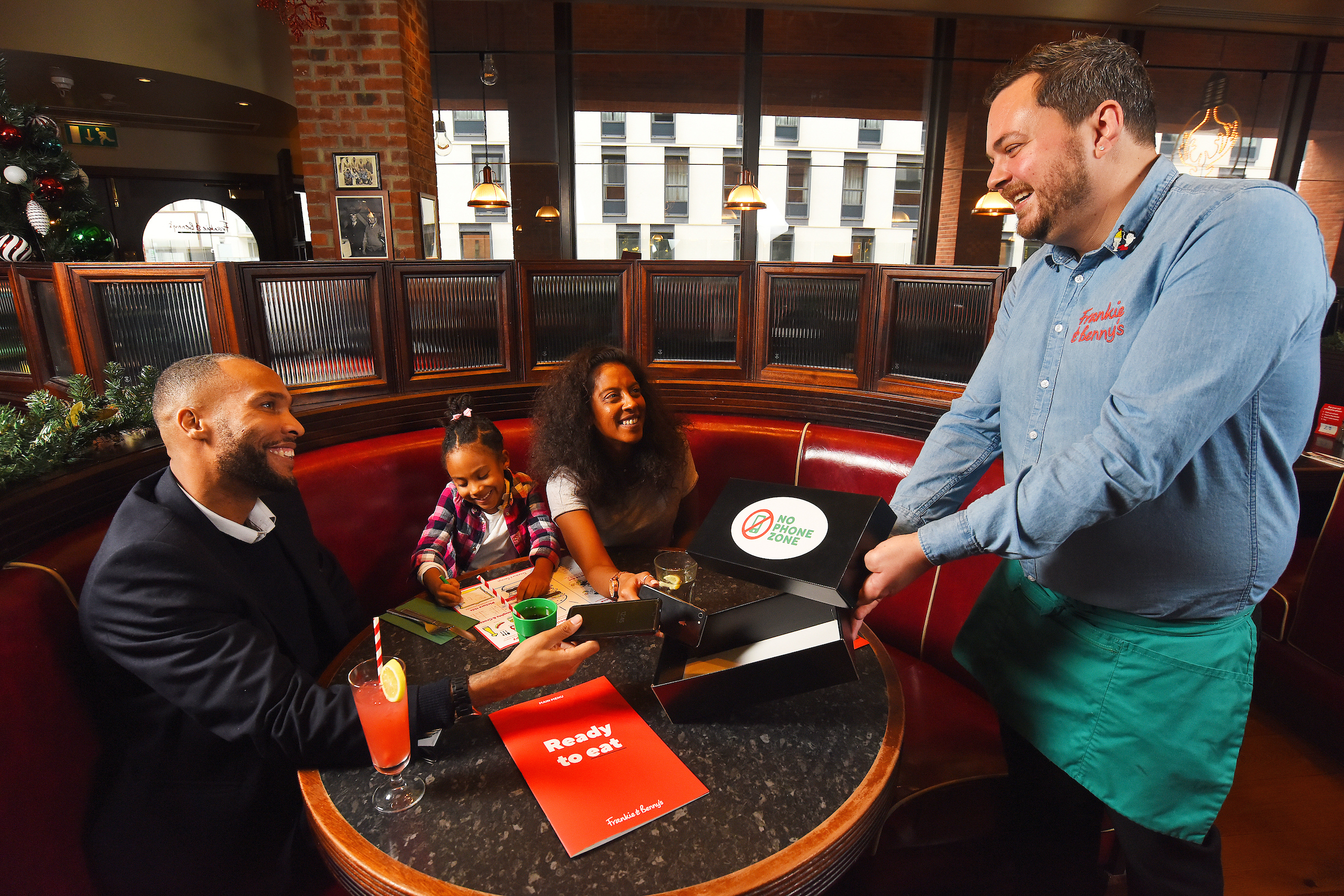 Frankie & Benny's has introduced no-phone zones in its 250 UK restaurants - where diners are encouraged to place their devices in a box on arrival at the table and free children's meals are offered as an incentive.