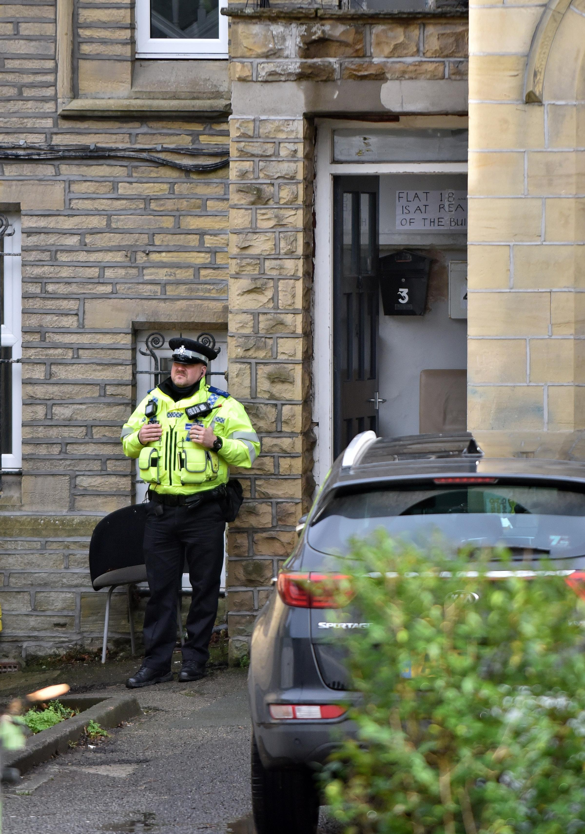 A police officer guards the scene on Keighley Road, Frizinghall