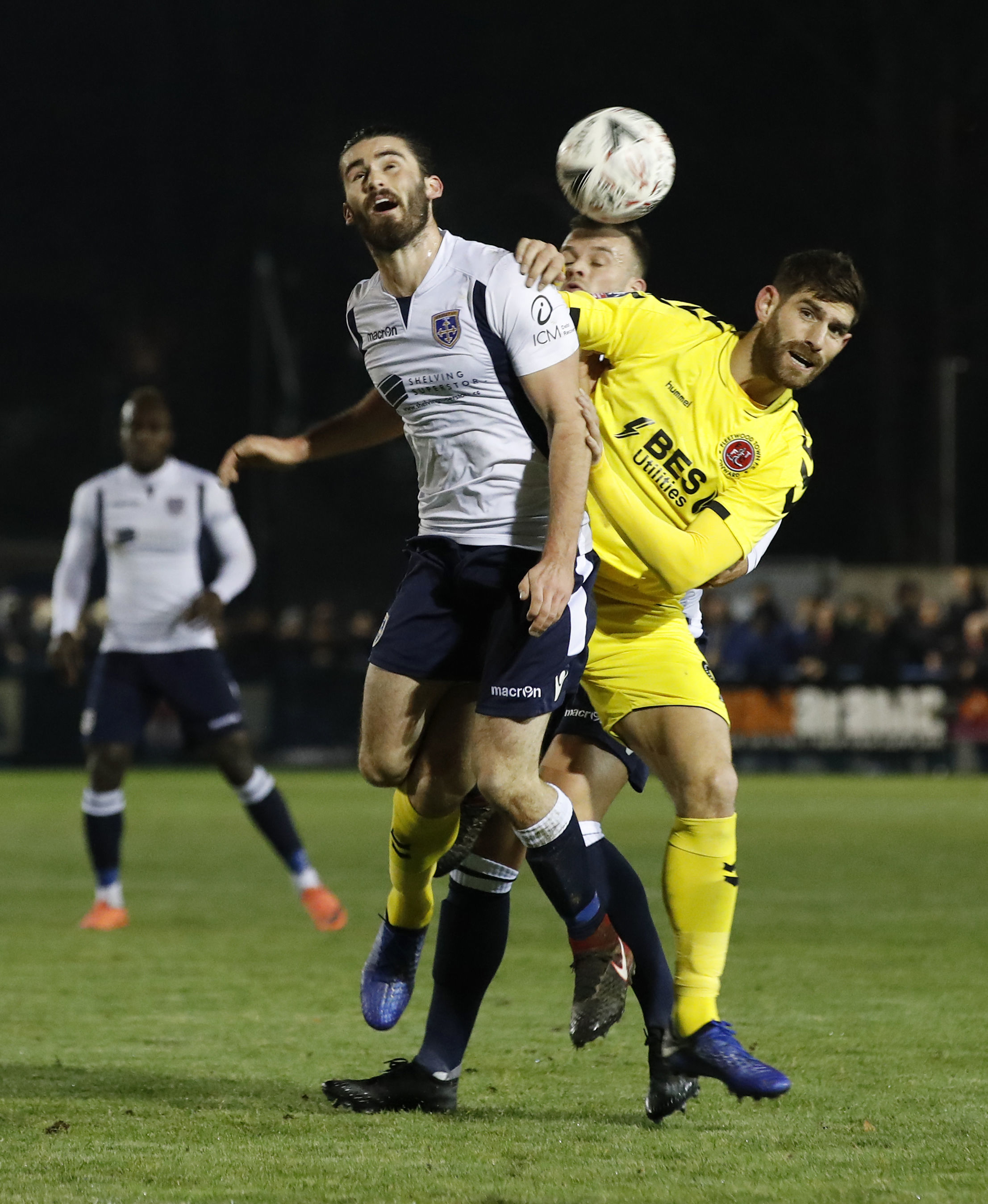 Guiseley's Alex Purver and Fleetwood Town's Ched Evans, right, battle for the ball during the FA Cup second round clash between the two sides. Picture: Martin Rickett/PA Wire