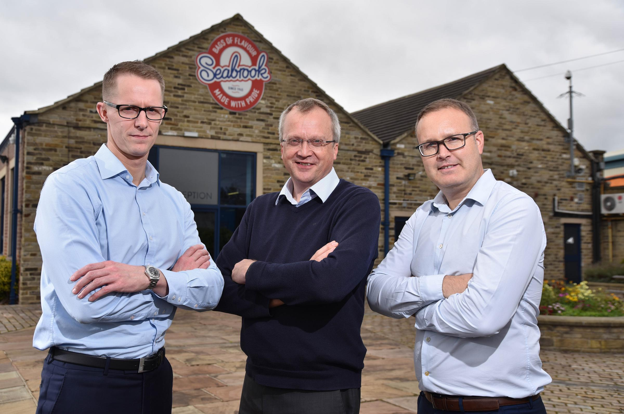 Seabrook Crisps bosses, including chief executive Jonathan Bye (middle)