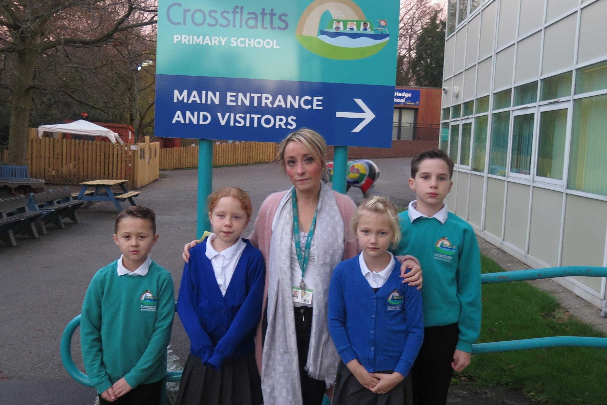 Crossflatts Primary head teacher Nicola Bennett with some of her pupils whose learning has been affected after valuable equipment was stolen from their school